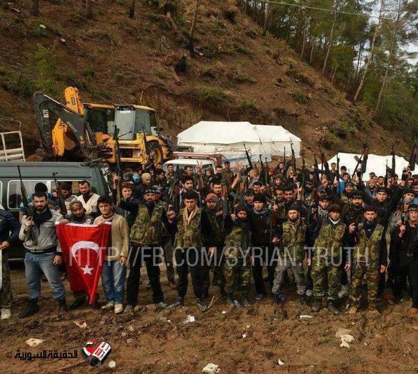 Photo- Brutal Terrorists in Syria raise Turkey's Flag