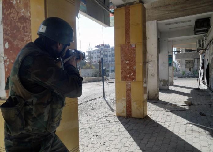Syrian-soldier-Damascus-696x496