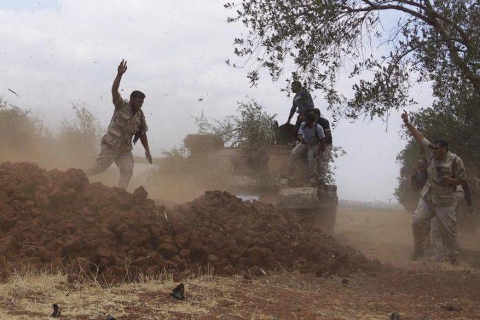 FSA-rebels-in-Daraa-696x465