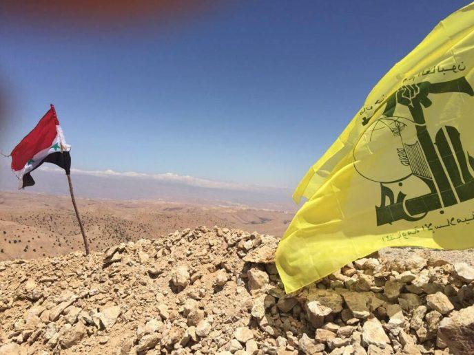 Hezbollah-Syrian-flags-688x516
